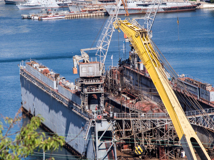 High angle view of cranes at commercial dock