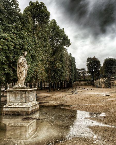 Rain in Paris is dramatically beautiful Paris, France  Rainy Days Weekends Statue Louvre Dramatic Sky