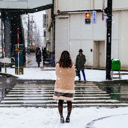 Waiting.... face to face Capture The Moment My Year My View From My Point Of View My Traveling Photography My Street Photography Snow Winter Street Photography Cold Temperature Two People Snowing Sapporo City Street Urban Exploration Urban Photography Sapporo The Street Photographer - 2017 EyeEm Awards