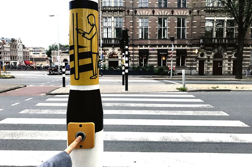 EyeEm Selects Push the Button Street Road City Architecture City Street Outdoors Day City Life Road Sign Finger Crossing Urban Urban Geometry Urbanphotography EyeEm Best Shots From My Point Of View Streetphotography in Amsterdam , Netherlands Urban Impressions Your Ticket To Europe Mix Yourself A Good Time Paint The Town Yellow Be. Ready. An Eye For Travel
