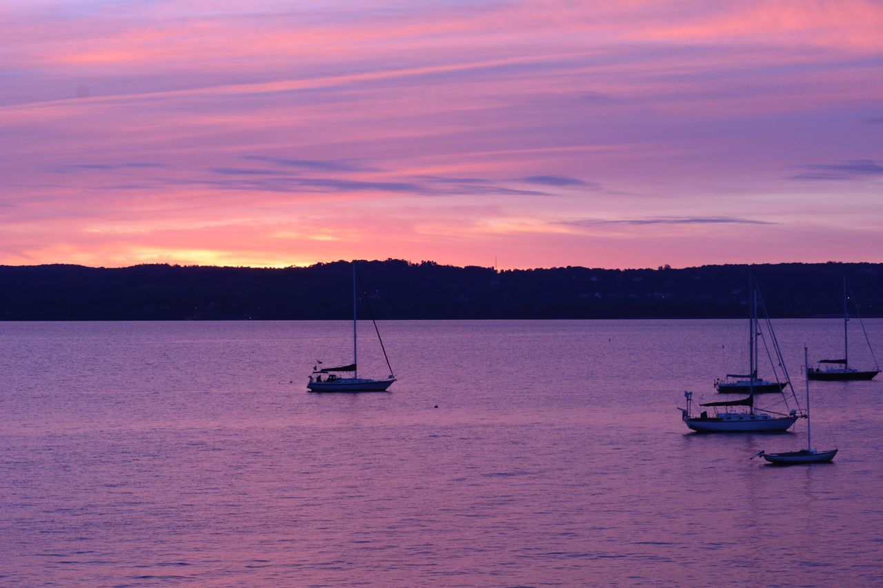 Boats Moored On River Against Sky During Sunset
