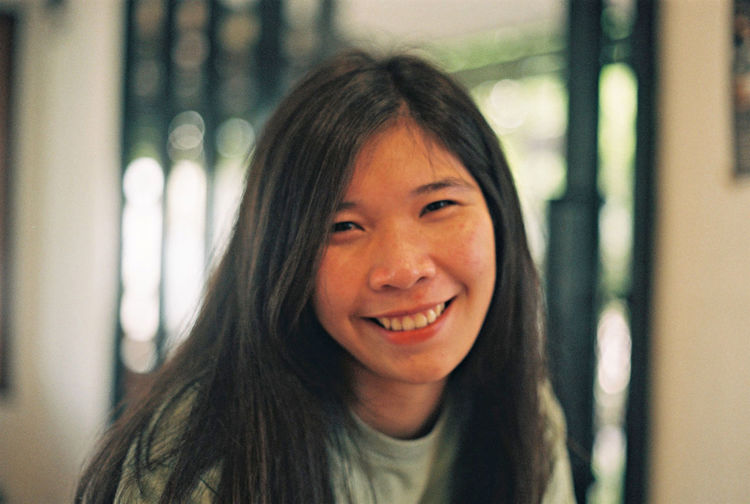 Portrait of smiling young woman at home