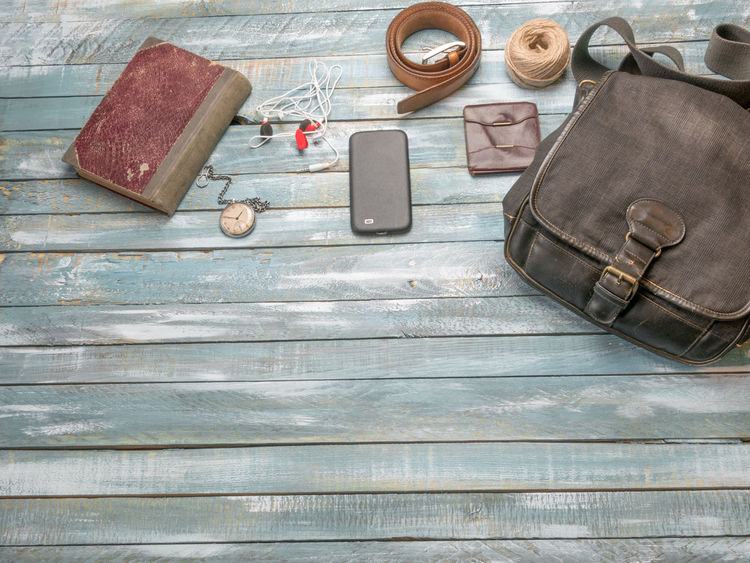 Travel concept. Accessories for men on the vintage wooden floor Accesories Concept Day High Angle View Indoors  Man No People Perfume Travel Vintage Wallet