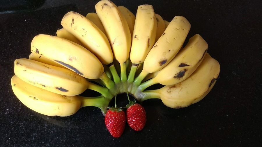 married Yellow Fruit Bananas Eyeem Market Black Background Fruit Yellow Red Banana Close-up Food And Drink Strawberry