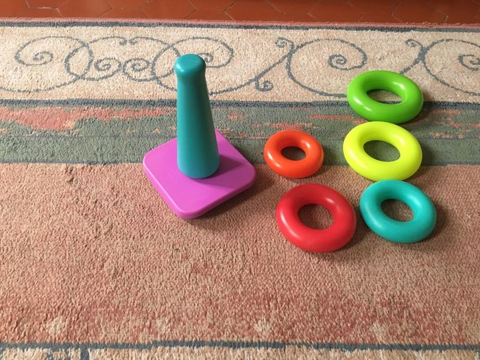 High Angle View Of Toys On Carpet