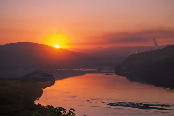 Sunet over a river in KwaZulu Natal, South Africa Nature South Africa Beauty In Nature Kwazulu Natal Mountain No People Orange Color Outdoors Reflection Sky Sunlight Sunset Tranquil Scene Tranquility Water