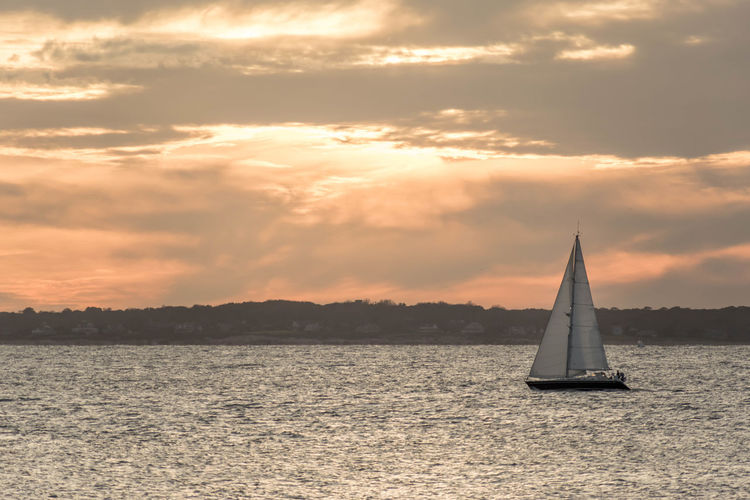 Holiday Travel Traveling Beauty In Nature Canvas Cloud - Sky Idyllic Mode Of Transportation Nature Nautical Vessel No People Orange Color Outdoors Sailboat Sailing Scenics - Nature Sea Sky Sunset Sunsets Tranquil Scene Tranquility Transportation Water Waterfront