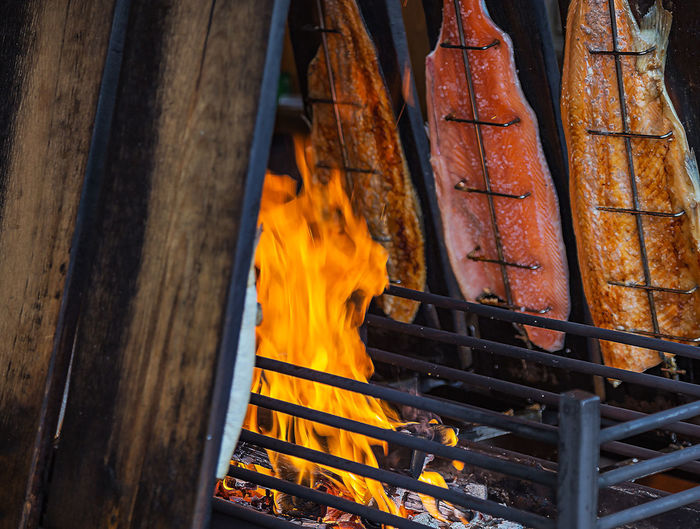 Close-Up Of Fish By Grill