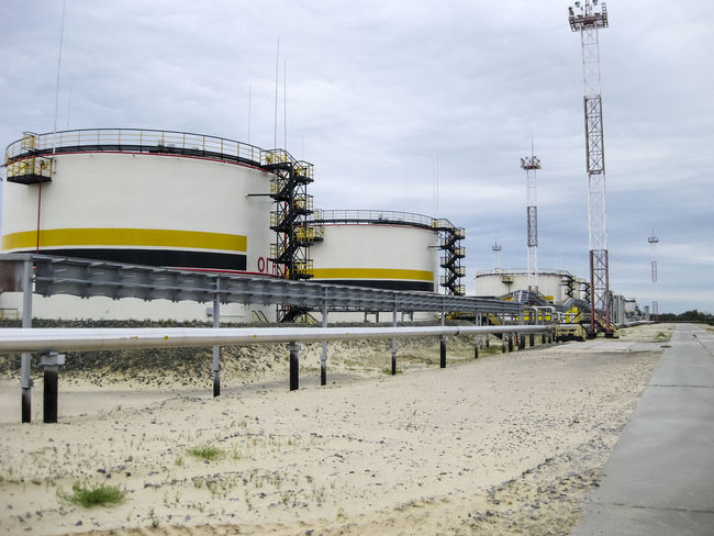Oil Oil Pump Gas Gasprom Rosneft Refinery Industry Sky Fuel And Power Generation Nature Day Oil Industry Storage Tank Built Structure No People Architecture Outdoors Technology Factory Transportation Cloud - Sky Fuel Storage Tank Land Connection Oil Refinery