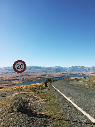 Road Clear Sky Blue Road Sign Day Landscape Speed Limit Sign Sky No People The Way Forward Winding Road Mountain Outdoors Roadtrip New Zealand