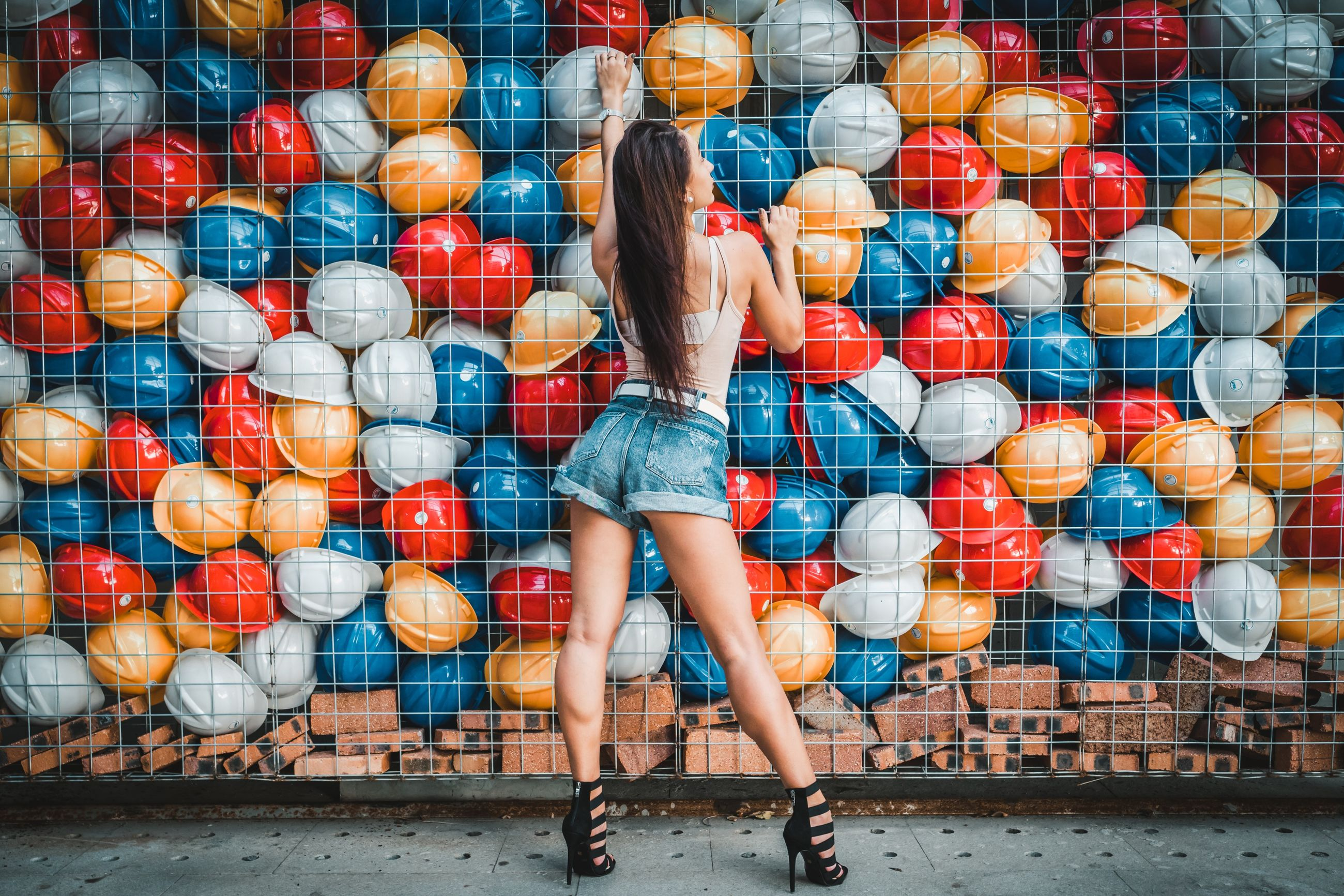 one person, full length, women, adult, young adult, real people, fashion, young women, rear view, lifestyles, long hair, hairstyle, casual clothing, architecture, hair, standing, motion, shoe, city, beautiful woman