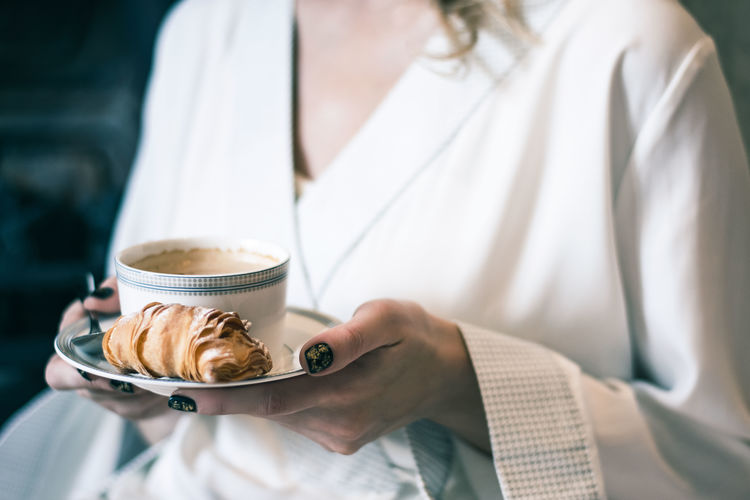 Breakfast Cappuccino Close-up Coffee - Drink Coffee Cup Croissant Day Drink Food Food And Drink Freshness Holding Human Hand Indoors  Midsection One Person People Plate Real People Refreshment Women EyeEm Ready   Food Stories