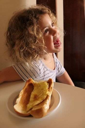 Childhood Food And Drink Food Real People One Person Girls Indoors  Curly Hair Elementary Age Freshness Eating Close-up People