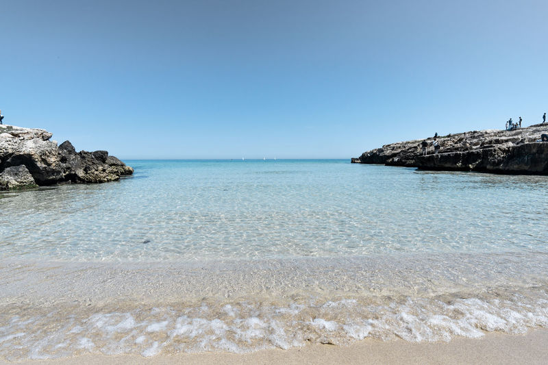 Water Sea Sky Beach Beauty In Nature Land Scenics - Nature Clear Sky Tranquil Scene Tranquility Rock Nature No People Rock - Object Day Horizon Solid Copy Space Idyllic Horizon Over Water Outdoors Shallow Puglia Puglia South Italy Pugliagram Puglia_city Puglia, Italy Apúlia Apulia Italy Italia Puglia Apulian Landscape Monopoli