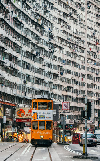 Architecture Building Built Structure City City Life City Street Day Daytime Hong Kong HongKong Information Sign Land Vehicle Mode Of Transport Outdoor Photography Outdoors Parking Lot Road Train Transportation Travel Destinations Traveling