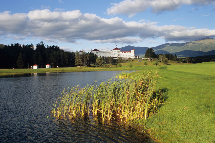 Lake side view of Mount Washington Hotel in Bretton Woods Bretton Woods Resort Mount Washington Cog Railway New Hampshire, USA Architecture Beauty In Nature Building Building Exterior Built Structure Cloud - Sky Day Grass Growth Hotel House Lake Land Lush Greenery Nature No People Outdoors Plant Reflection Sky Tree Water