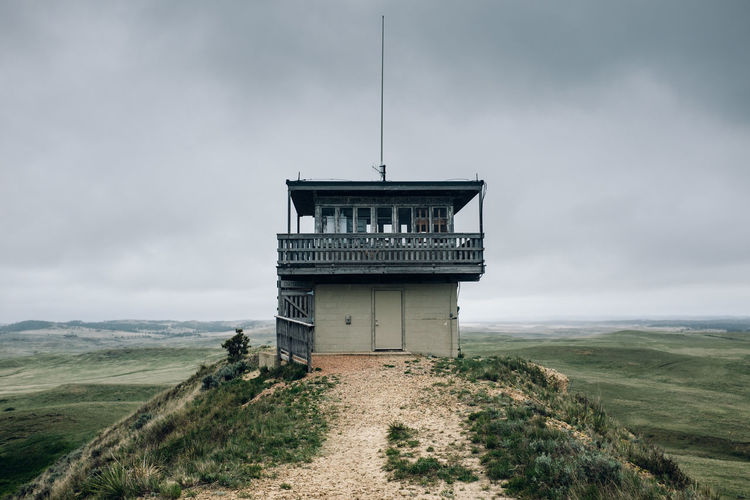 Wyoming Architecture Building Building Exterior Built Structure Cloud - Sky Day Environment Field Fire Lookout Tower Grass Land Landscape Nature No People Non-urban Scene Outdoors Plant Scenics - Nature Sky Tower