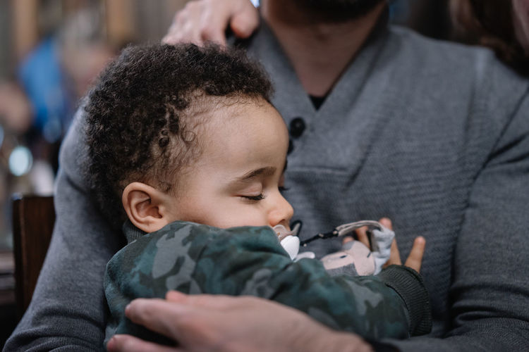 Close-up of man holding a baby
