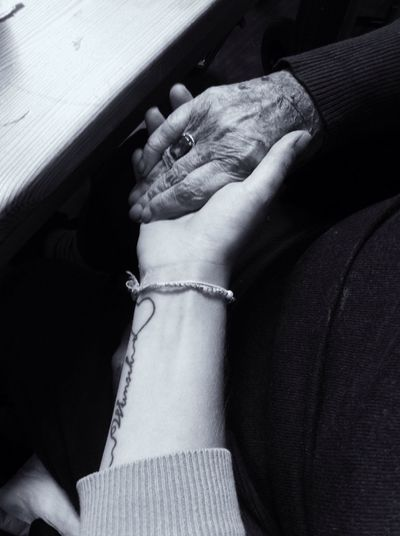 Cropped Woman Hand Holding Grandmother