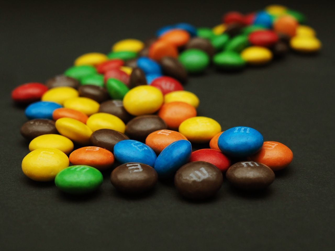 multi colored, still life, colorful, large group of objects, sweet food, variation, food and drink, close-up, table, indoors, indulgence, no people, temptation, arrangement, focus on foreground, choice, food, dessert, candy, studio shot, black background, ready-to-eat, freshness