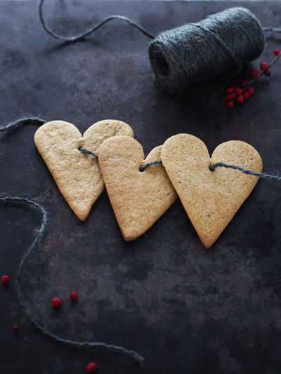 High angle view of heart shape cookies on table