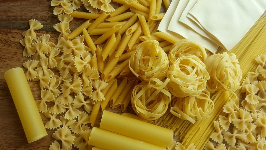 High angle view of various dried pasta