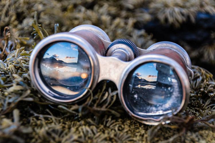 Close-up of binoculars on grass