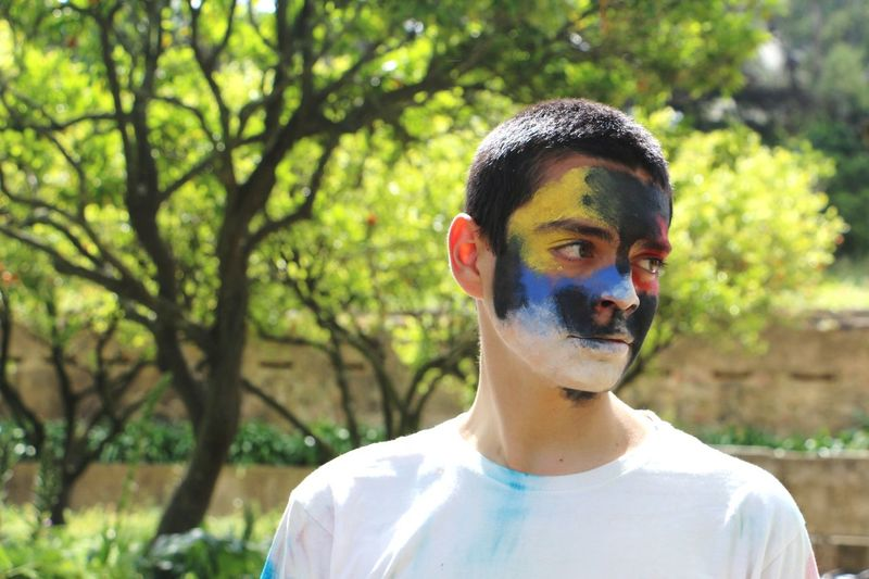 Close-up of teenage boy with face paint at park