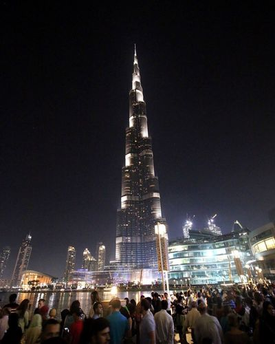 Night Large Group Of People Travel Destinations Illuminated Tourism City Architecture Tower Built Structure Lifestyles Building Exterior Leisure Activity Outdoors Sky Women Real People Burj Khalifa Dubai❤ Tallest Building Crowd Skyscraper