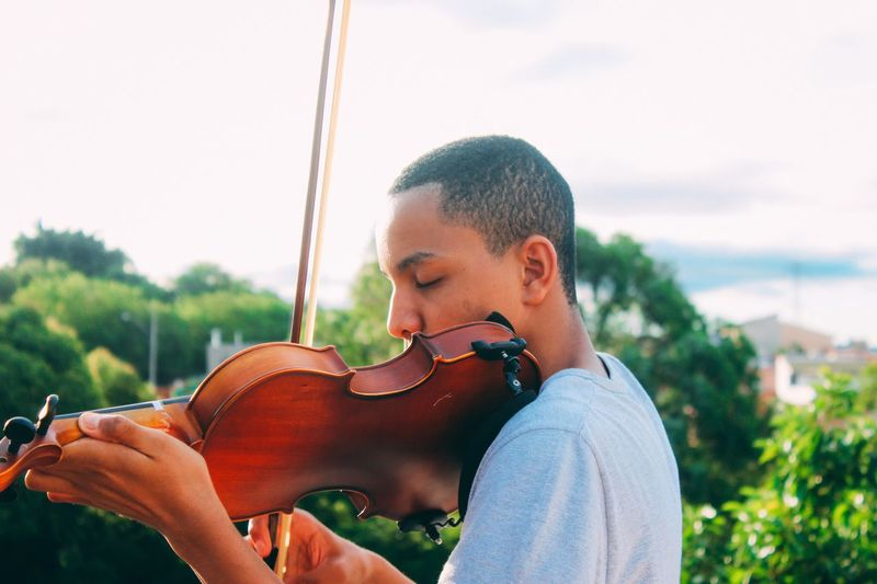 Teenage boy playing violin