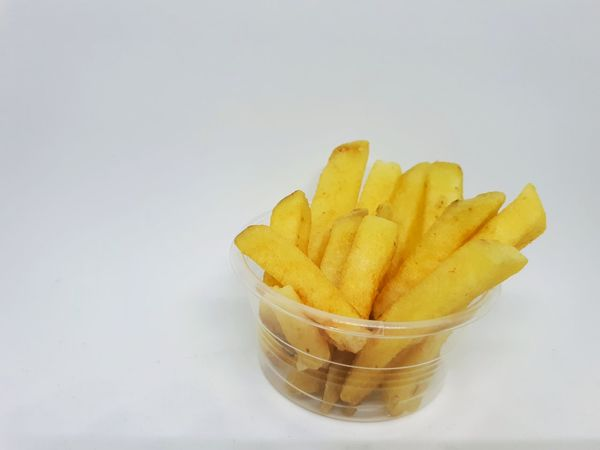 French Fries Sweet Potato Fried Cup Plastic Transparent Ready-to-eat Fast Food Snack Recipe Hygiene Studio Shot White Background No People Indoors  Food Healthy Eating Stick Baked Crispy Tasty Delicious