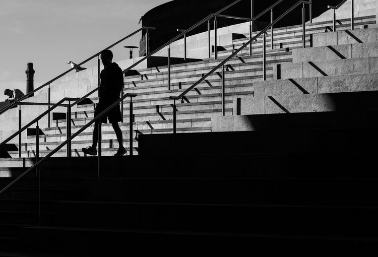 Steps in a shopping centre, Liverpool One, in brilliant winter sunshine Architecture Black And White Blackandwhite People Railing Real People Shadow Silhouette Staircase Steps Steps And Staircases Street Photography Streetphotography Walking