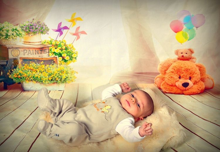 Baby Cute One Person Indoors  Babies Only People Multi Colored Flower New Life Happiness Portrait Lying Down Smiling Newborn Bed Full Length Cheerful Childhood Real People Bedroom