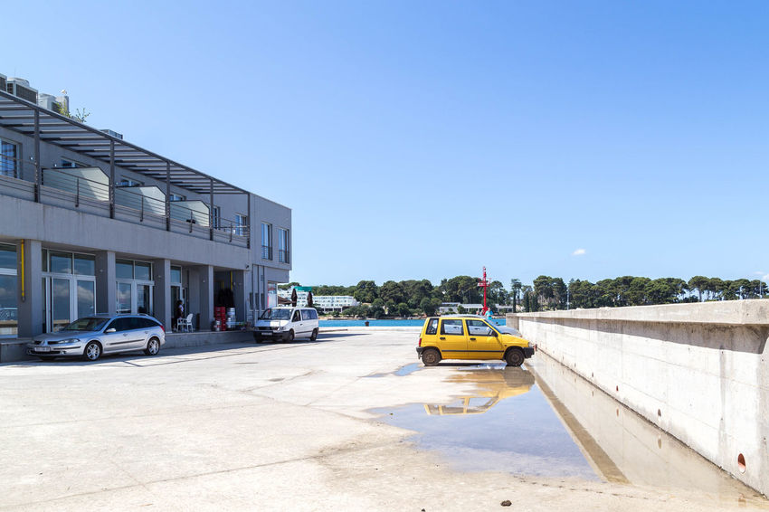 Poreč harbour... Blue Skies Car Park Cars Croatia Porec, Croatia Poreč Harbour Poreč Marina Poreč Street Reflection Architecture Blue Sky Building Exterior Built Structure Car Clear Sky Land Vehicle Mode Of Transport Parked Parked Car Porec Puddle Sky Street Transportation Yellow Car