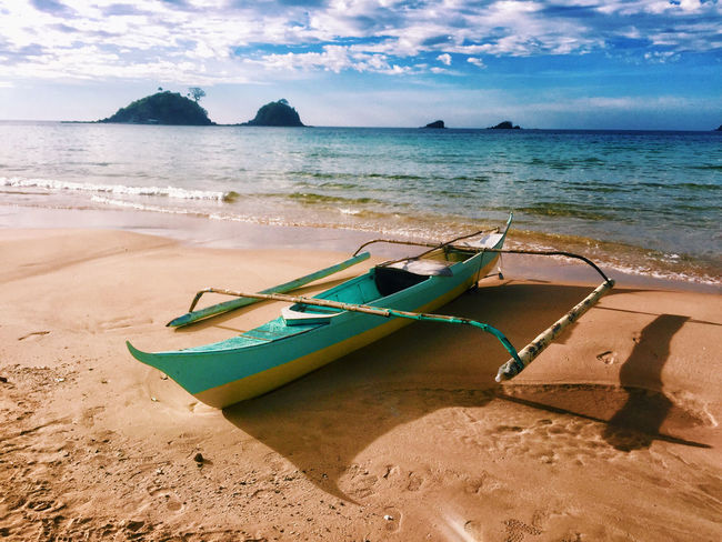 Beach Beauty In Nature Cloud - Sky Day Horizon Over Water Longtail Boat Mode Of Transport Moored Nature Nautical Vessel No People Outdoors Outrigger Sand Scenics Sea Shore Sky Tranquil Scene Tranquility Transportation Water