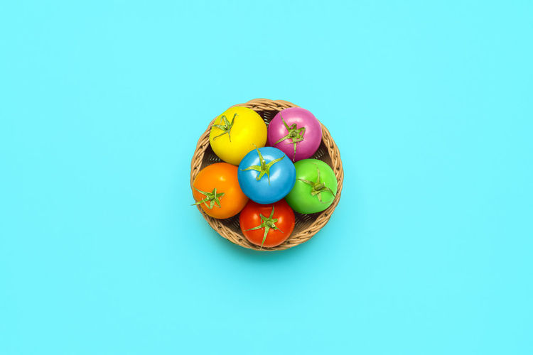 Directly above shot of multi colored candies on blue background