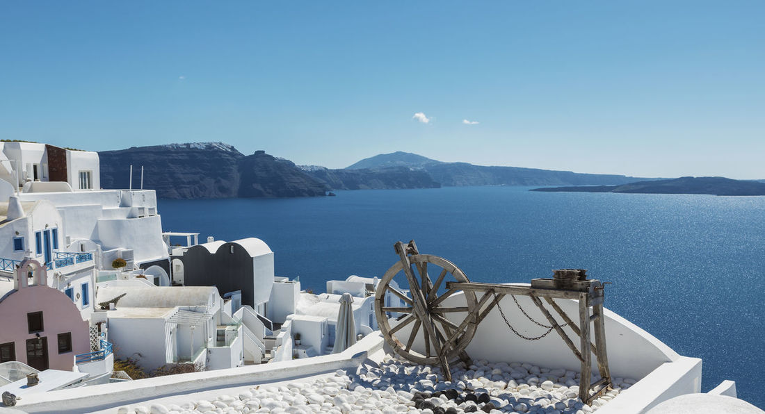 Santorini Caldera View Wheel Architecture Beauty In Nature Blue Building Exterior Built Structure Clear Sky Day Greece Idyllic Mountain Nature No People Oia Outdoors Santorini Scenics - Nature Sea Sky Sunlight Tranquil Scene Tranquility Water