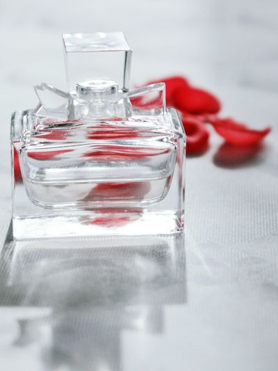Close-up of perfume on table