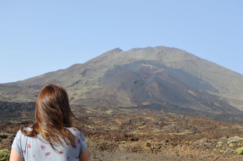 My girl and the Teide Teide Teide National Park Volcano Picoftheday EyeEm Best Shots EyeEmNewHere Eye4photography  Zowieyzen Mountain Clear Sky Young Women Women Headshot Rear View Hiking Blue Sunny Sky Volcanic Landscape Volcanic Crater Geology Arid Climate Sulphur Volcanic Rock Geyser Lava Rugged