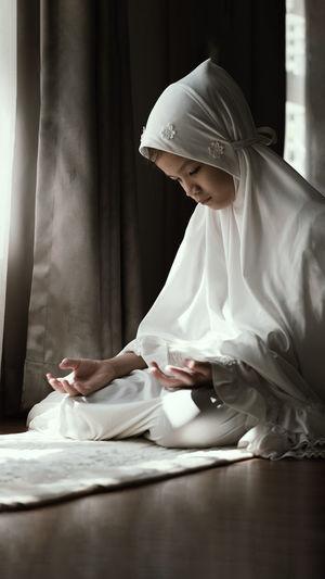 Girl praying at home