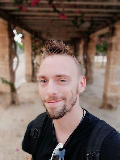 Close-Up Portrait Of Smiling Handsome Man
