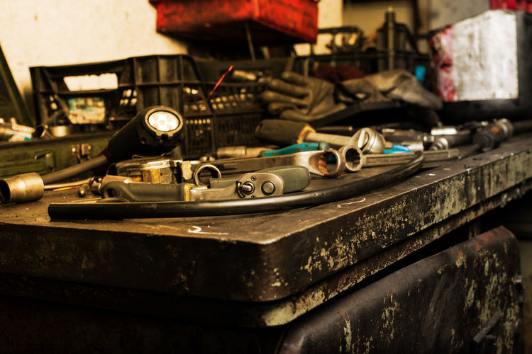 Mechanic tools on dirty work table Close-up Communication Connection Day Equipment Indoors  Metal Music No People Old Record Retro Styled Selective Focus Still Life Table Technology Transportation Turntable Work Tool