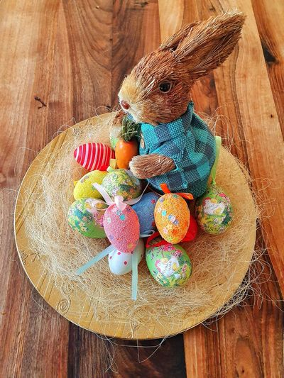 Multi colored easter eggs on wooden table