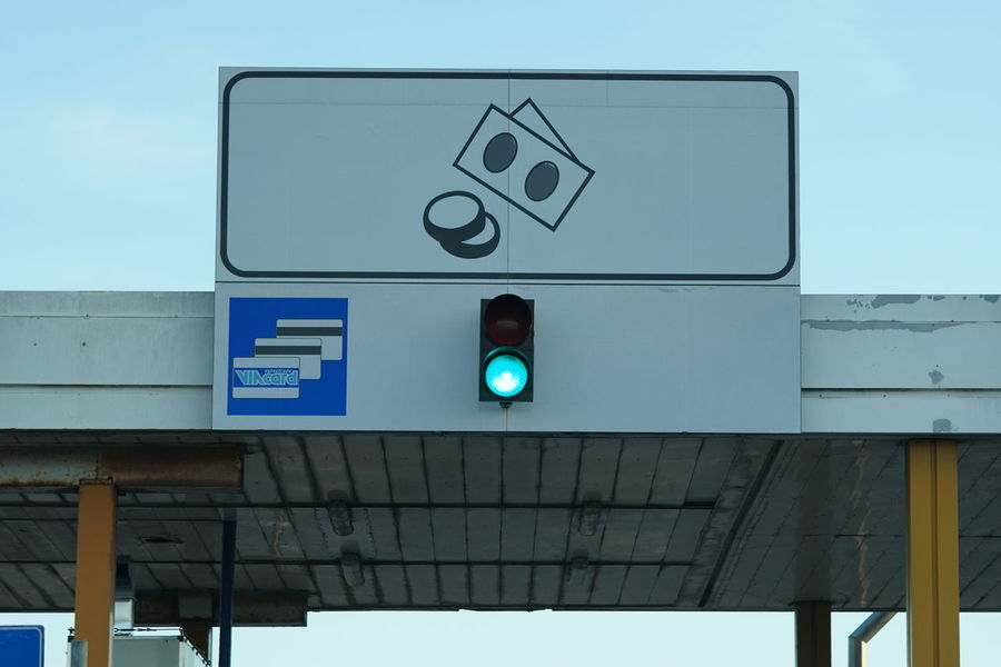 Rome, Italy - December 24, 2017: Italian motorway exit with green traffic light Forbidden Green Speedway Travel Trip Direction Guidance Highway Journey Motorway No People Permission Permit Permitted Road Sign