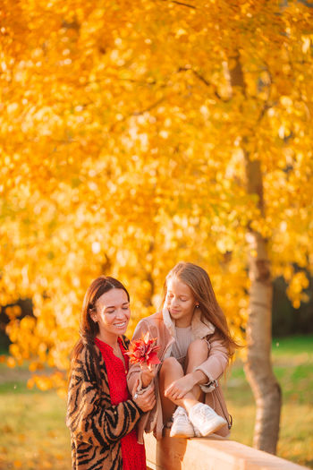 Young woman smiling during autumn