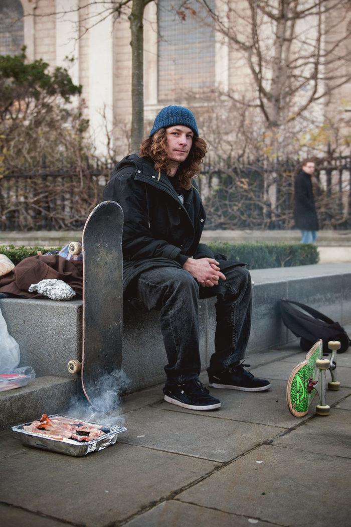 PORTRAIT OF MAN SITTING IN PARK