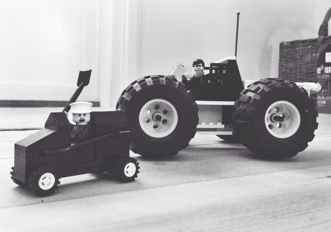 Just two boys, 20+, playing with some LEGO . Black And White