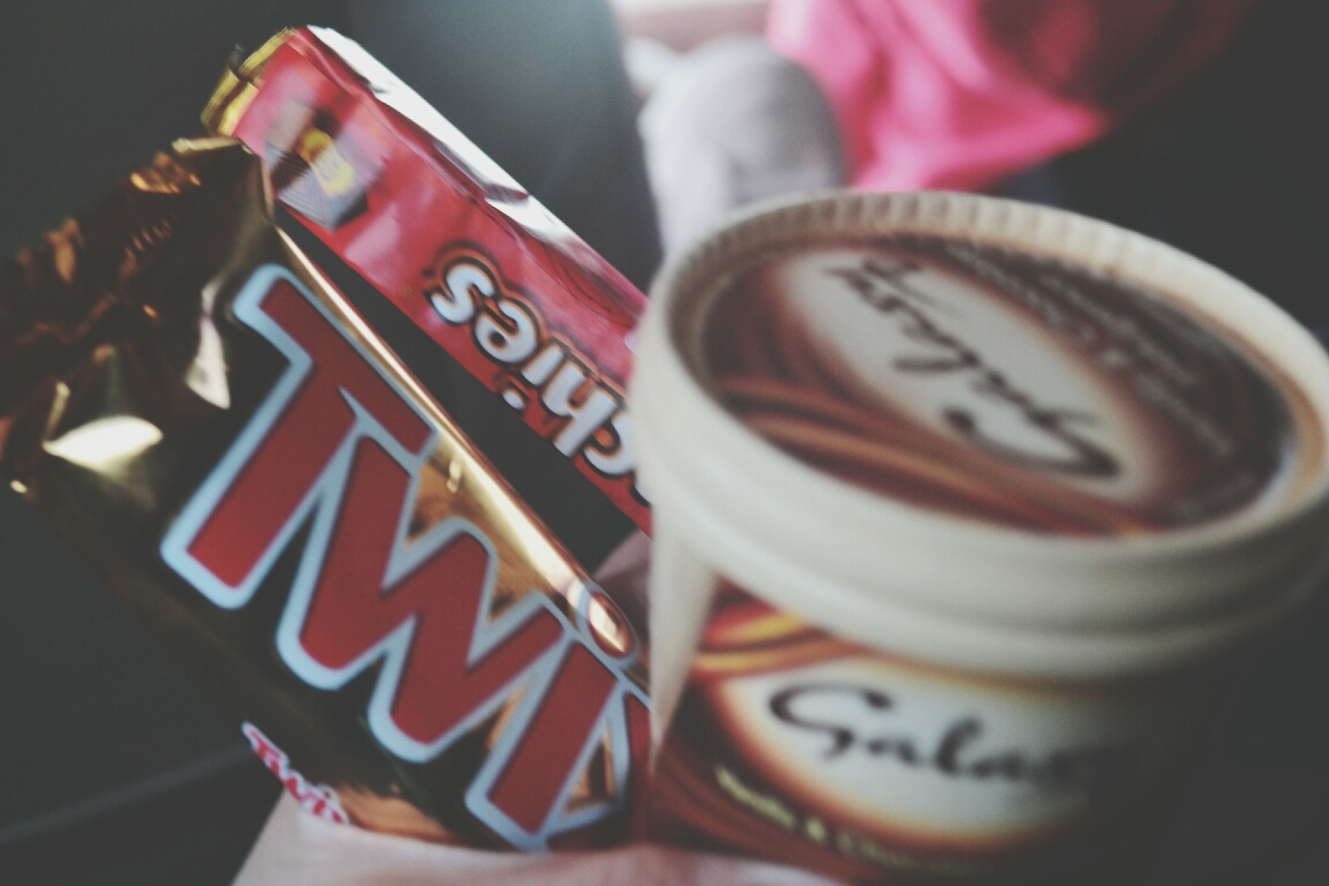 text, indoors, western script, communication, close-up, still life, focus on foreground, table, selective focus, food and drink, number, red, no people, high angle view, non-western script, capital letter, sweet food, heart shape, love, day