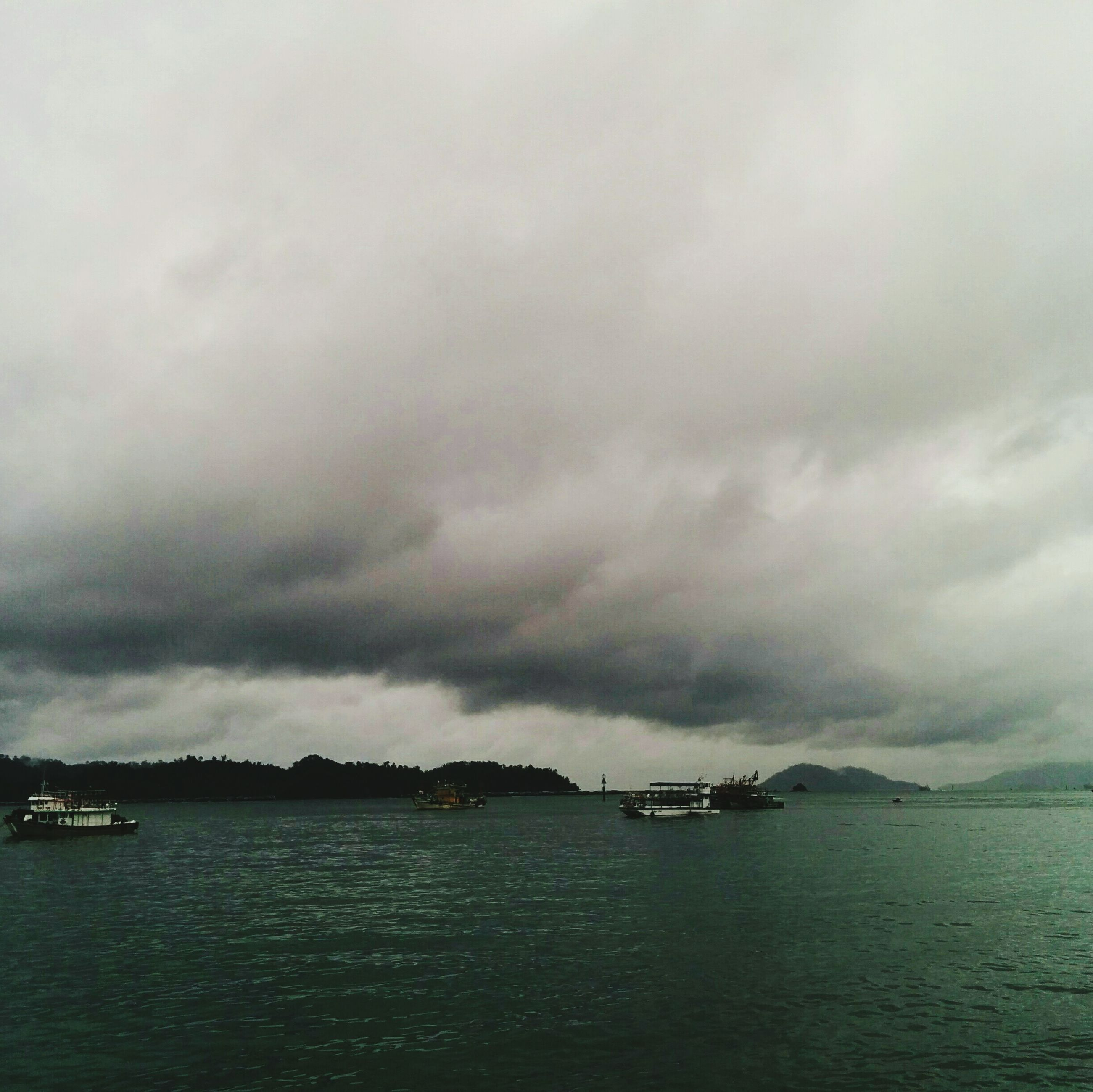 cloud - sky, sky, water, nature, beauty in nature, nautical vessel, scenics, sea, tranquility, outdoors, no people, waterfront, mode of transport, tranquil scene, storm cloud, rippled, day, built structure, sailing, architecture, building exterior, yacht, view into land
