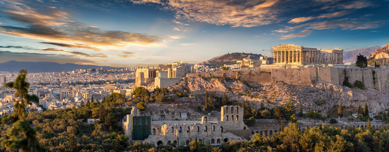 Panoramic view of the Parthenon Temple at the Acropolis of Athens, Greece, during sunset Ancient Greek Mediterranean  Parthenon Sightseeing Travel Acropolis Ancient Civilization Architecture Athens Attraction Building Exterior Built Structure City Cityscape Cloud - Sky Greece History Landmark Mountain Museum Sky Sunset Tourism Travel Destinations